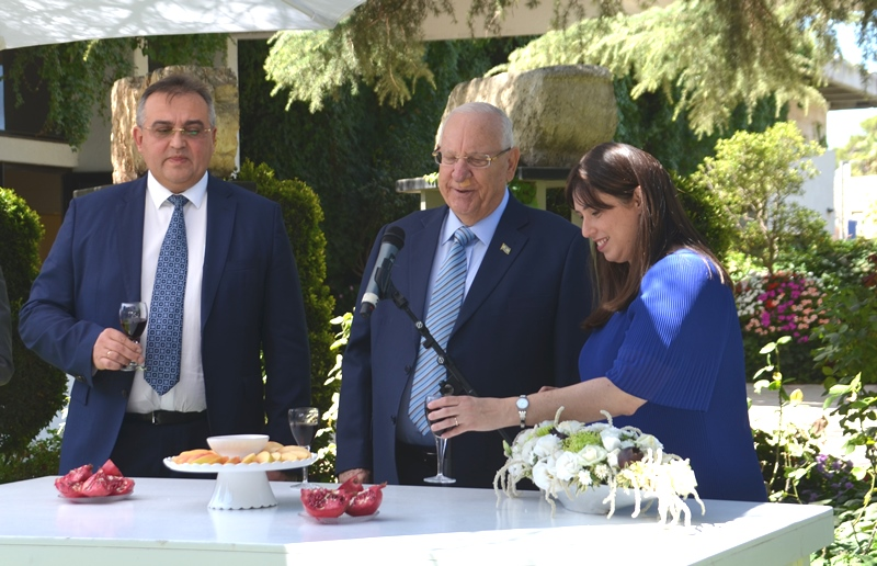 President Rivlin with wine and apples and honey for Rosh Hasahana
