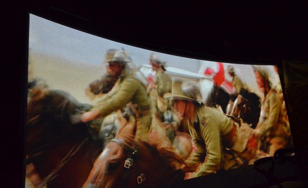 Blurry photo of Light Horsemen riding to Beer Sheva