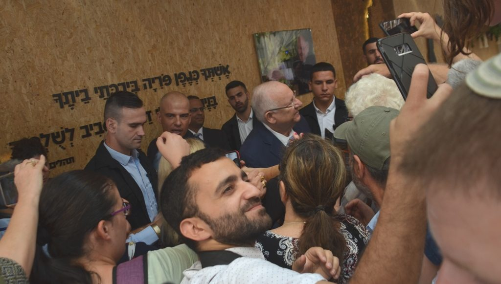 President Rivlin on Sukkot with public and man takes selfie