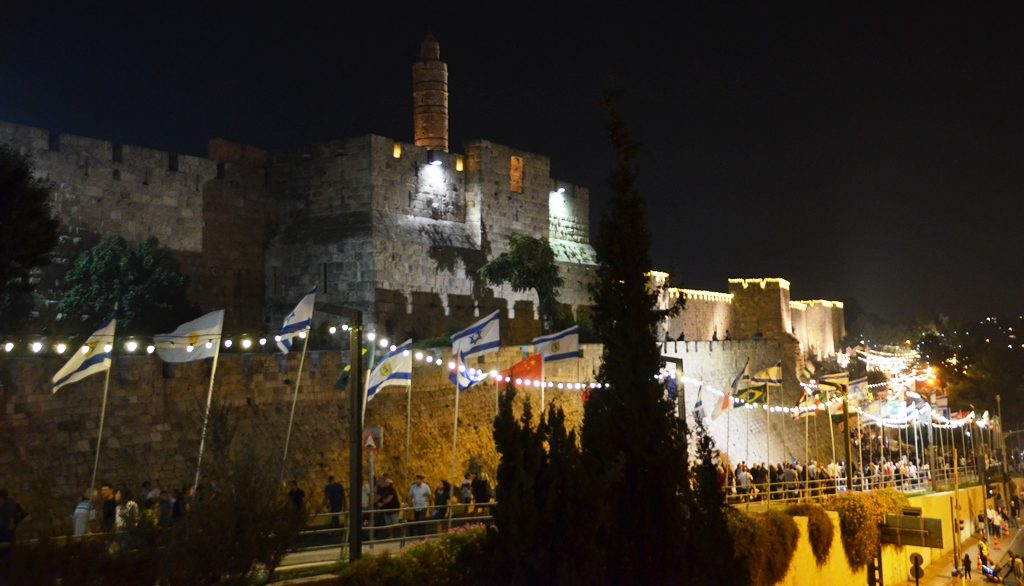 Crowds walking near Old City walls Jerusalem Israel on Sukkot