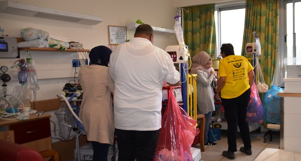 Baby in ALYN being treated by parents in hospital