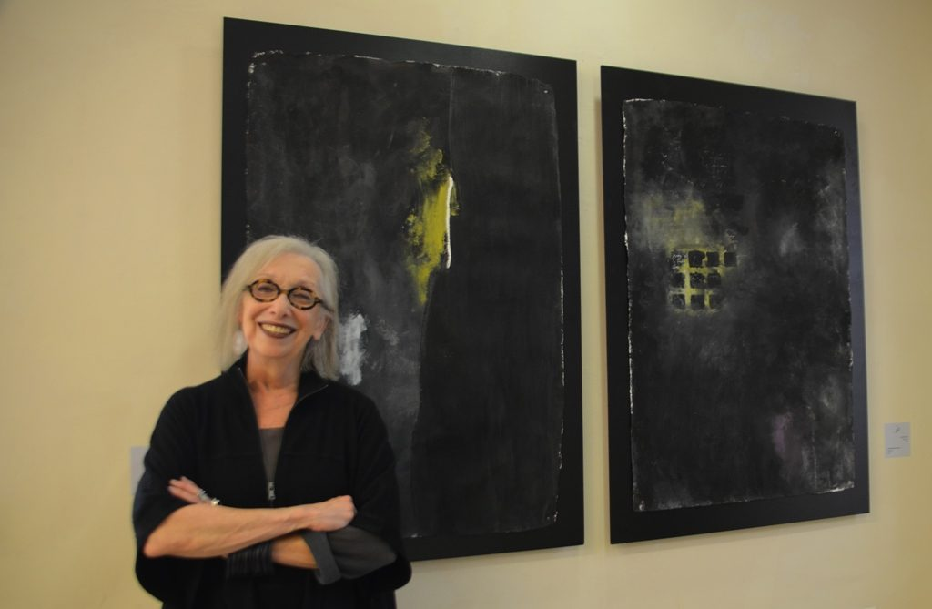 Artist with paintings in Jerusalem Biennale