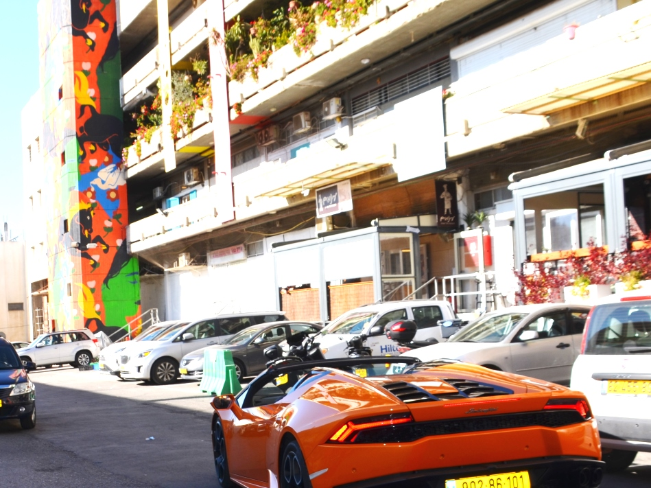 Orange Lamborghini in Jerusalem parking lot on Chanuak