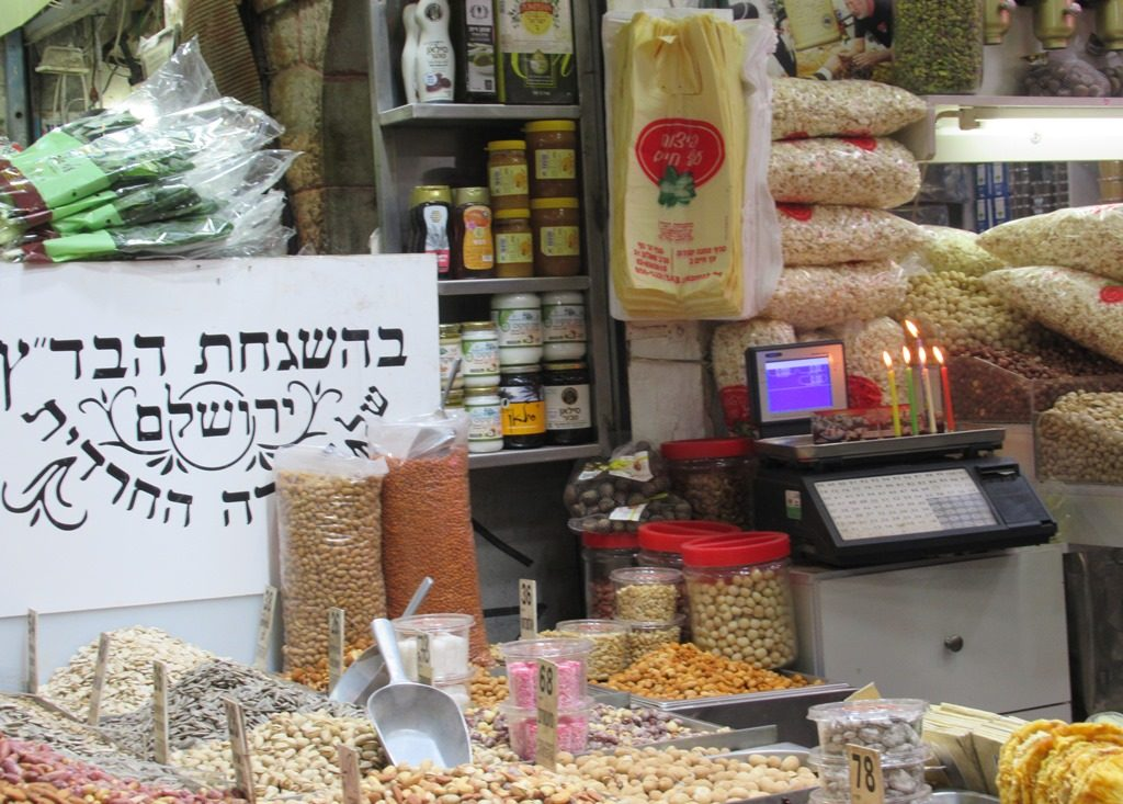 Shuk on Hanuka and candles lit in a store