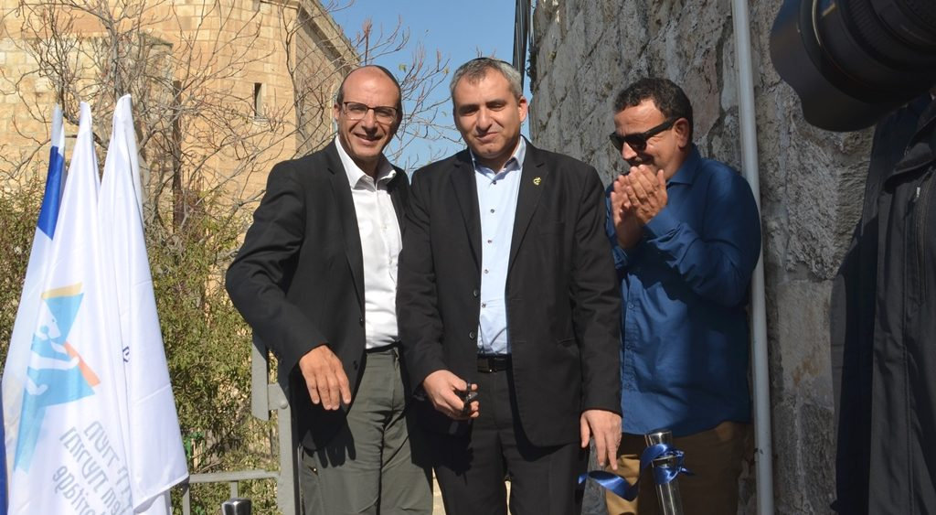 Jerusalem Minister Zeev Elkin cutting ribbon at opening of North Ramparts Walk