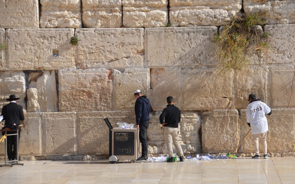 Cleaning notes from the Kotel before Hanukkah