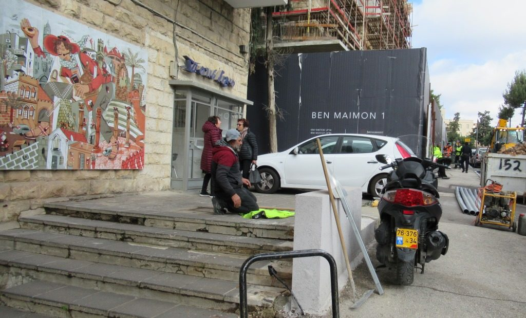 Jerusalem Israel construction site Muslim man using work vest as prayer rug