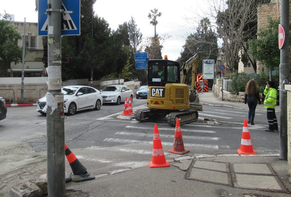 Road work on Jerusalem Israel street CAT piece of equipment