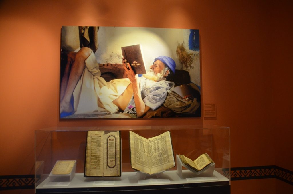 Yemenite man reading Hebrew book upside down in Naftali Hilger photo in Bible Lands Museum Jerusalem