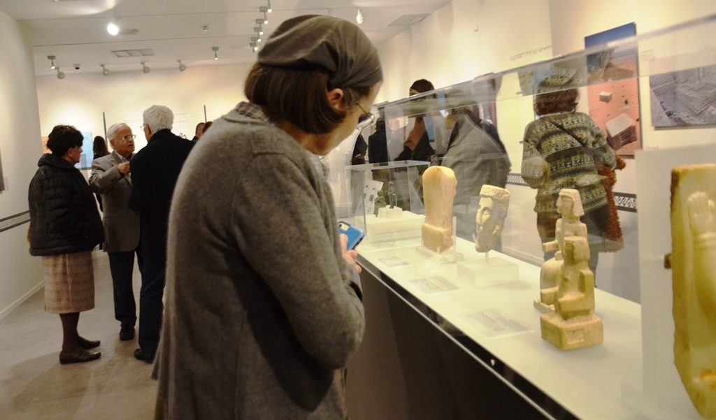 A woman looks at ancient artifacts from South Arabia now Yemen at Bible Lands Museum Jerusalem
