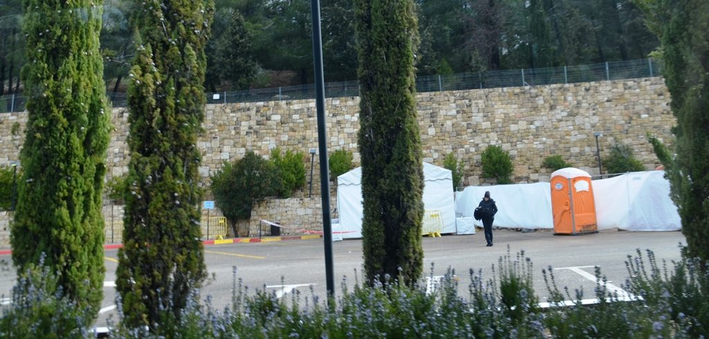 White security tents in Yad Vashem parking lot