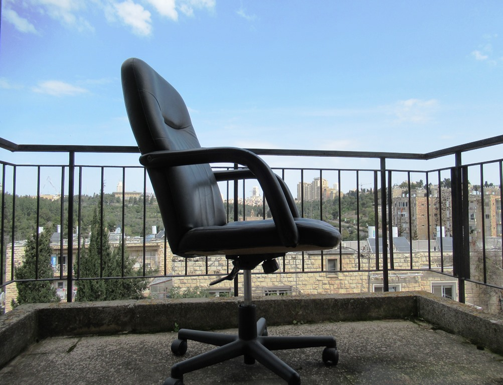 Jerusalem Israel view with chair outside COVID-19