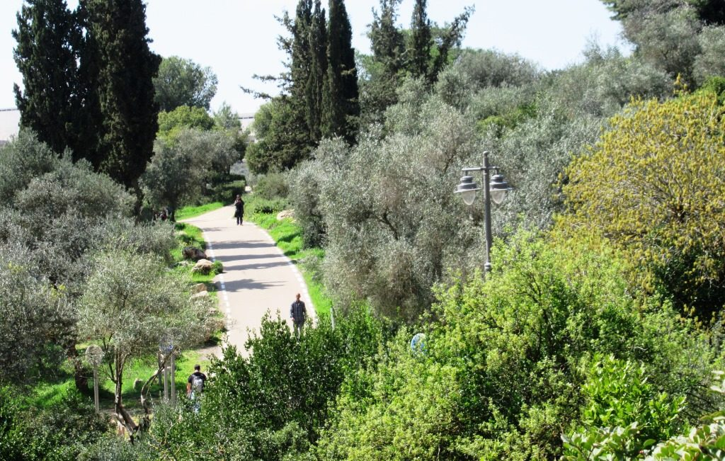 People walking on Valley of Cross path in Jerusalem Israel