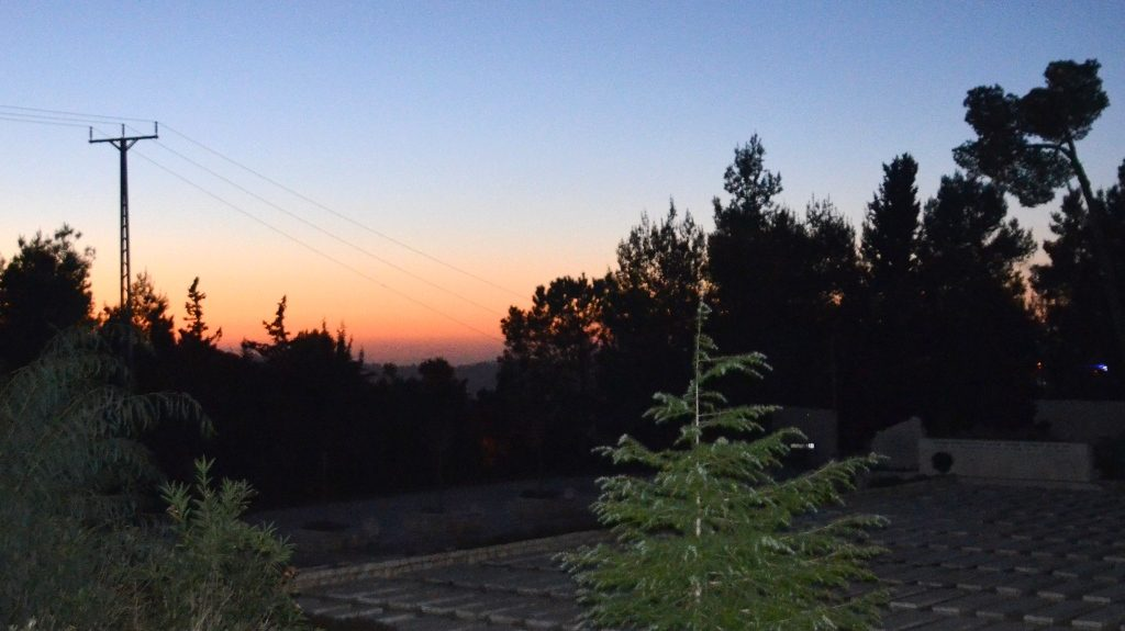Sun set over Har Herzl Cemetery in Jerusalem Israel