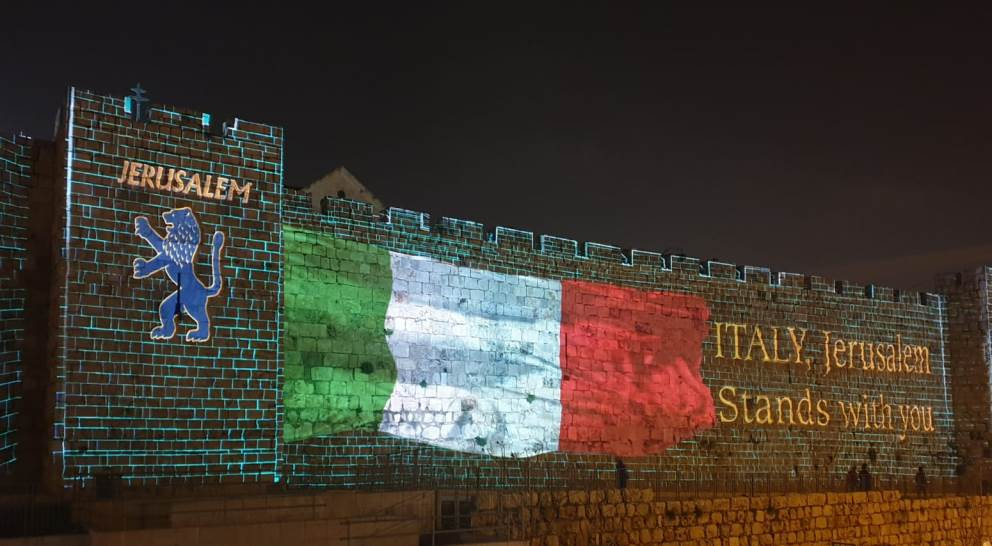 Projection of Italian flag on Old City Walls Jerusalem is with Italy, screen shot from Twitter Yuval Rotem