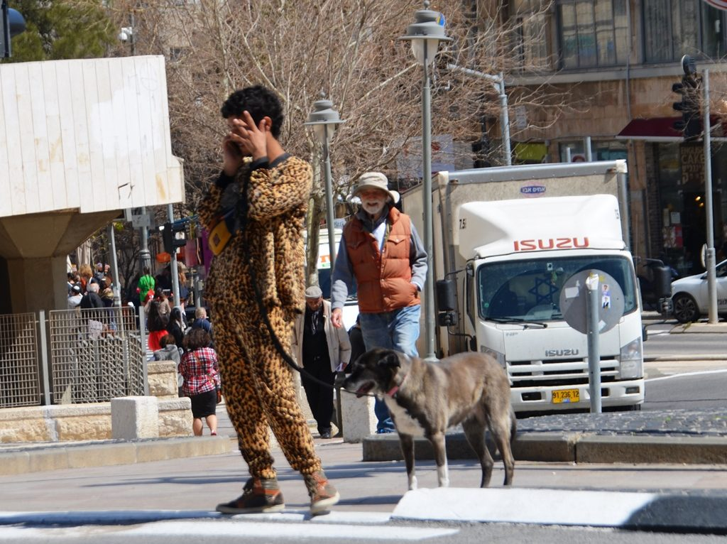 Purim costume man and dog in Jerusalem
