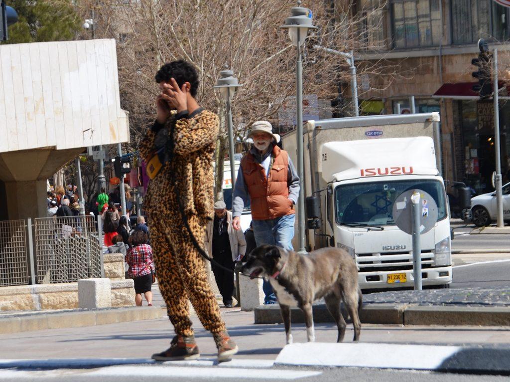 Purim costume man and dog in Jerusalem