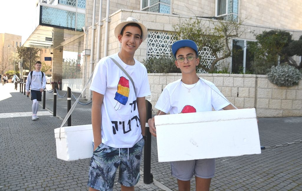 Two boys in Jerusalem dressed in Purim costumes as ice cream sellers