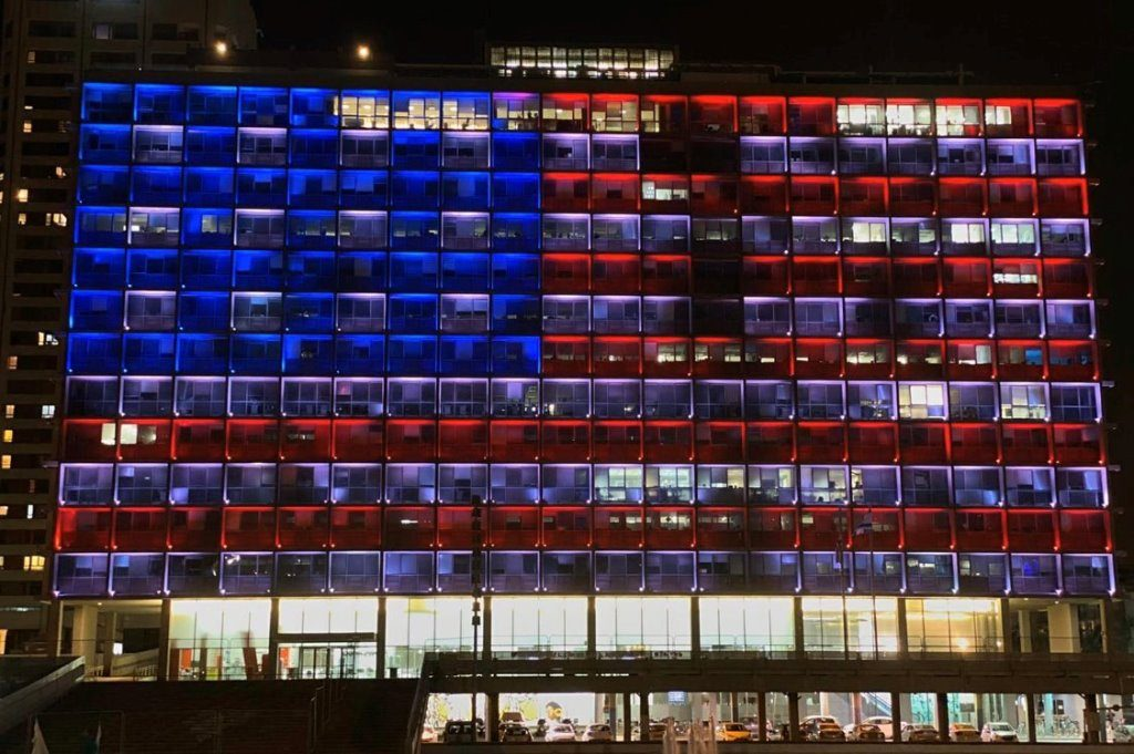 Tel Aviv municipal building lit as US flag to show support in COVID-19