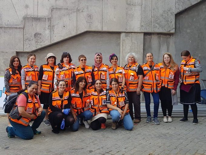 Women volunteers of United Hatzalah pose for group photograpn