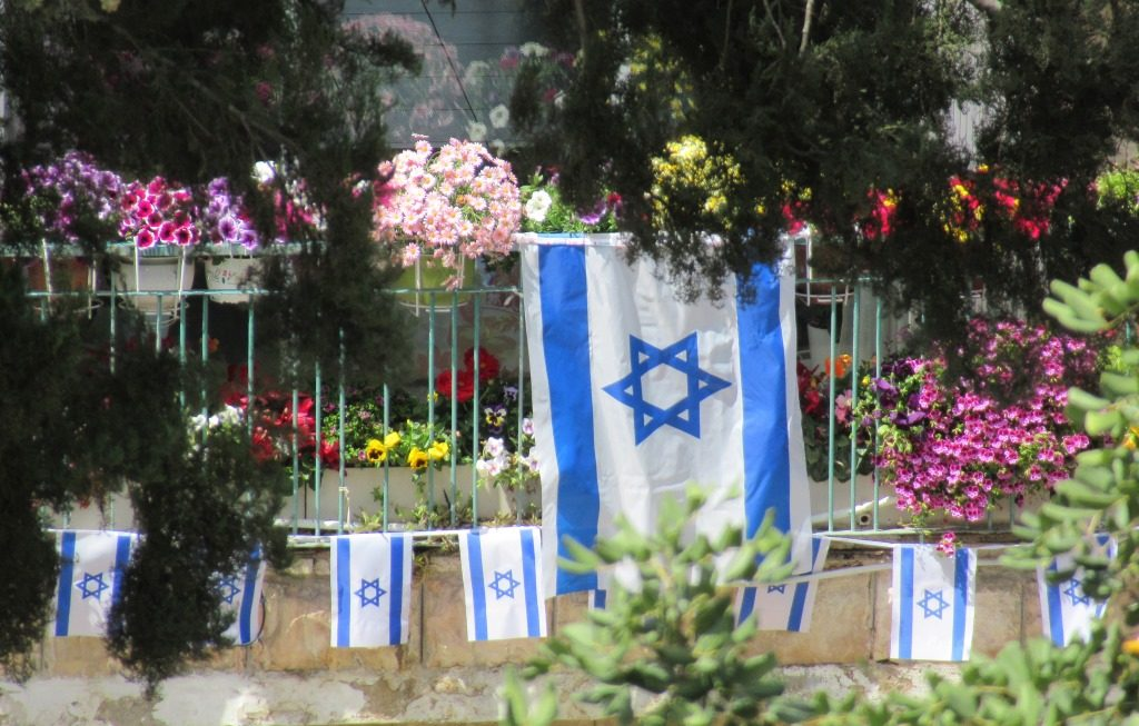 Yom HaZikaron and Yom Haatzmaut flags and flowers