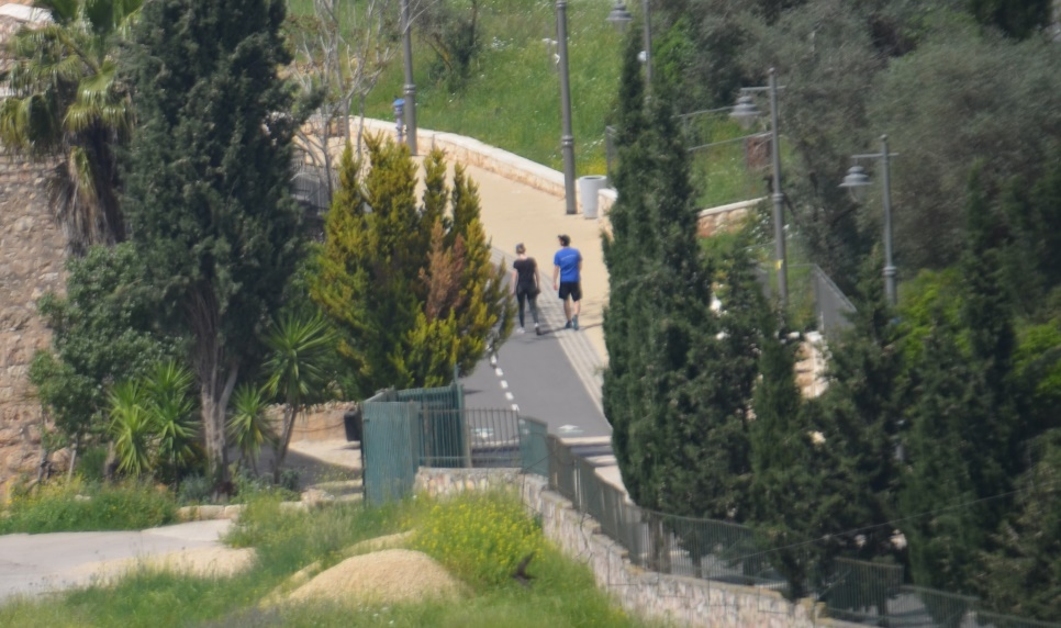 Jerusalem two people walking on path coronavirus time