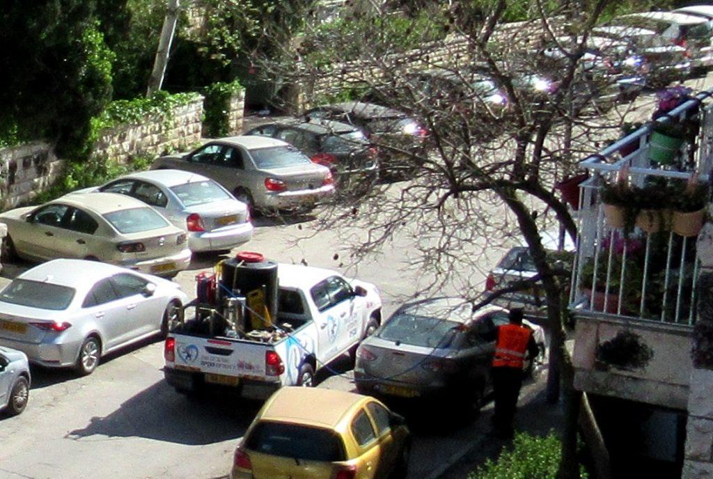 Truck spraying Jerusalem streets coronavirsu