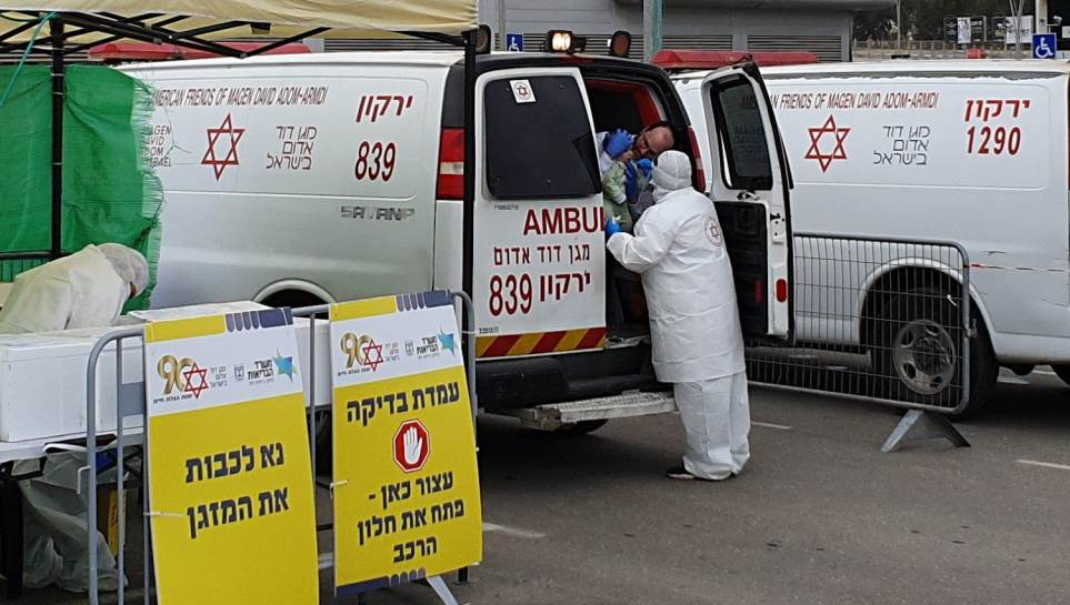 Israeli child being tested for COVID-19 in a MDA emergency van