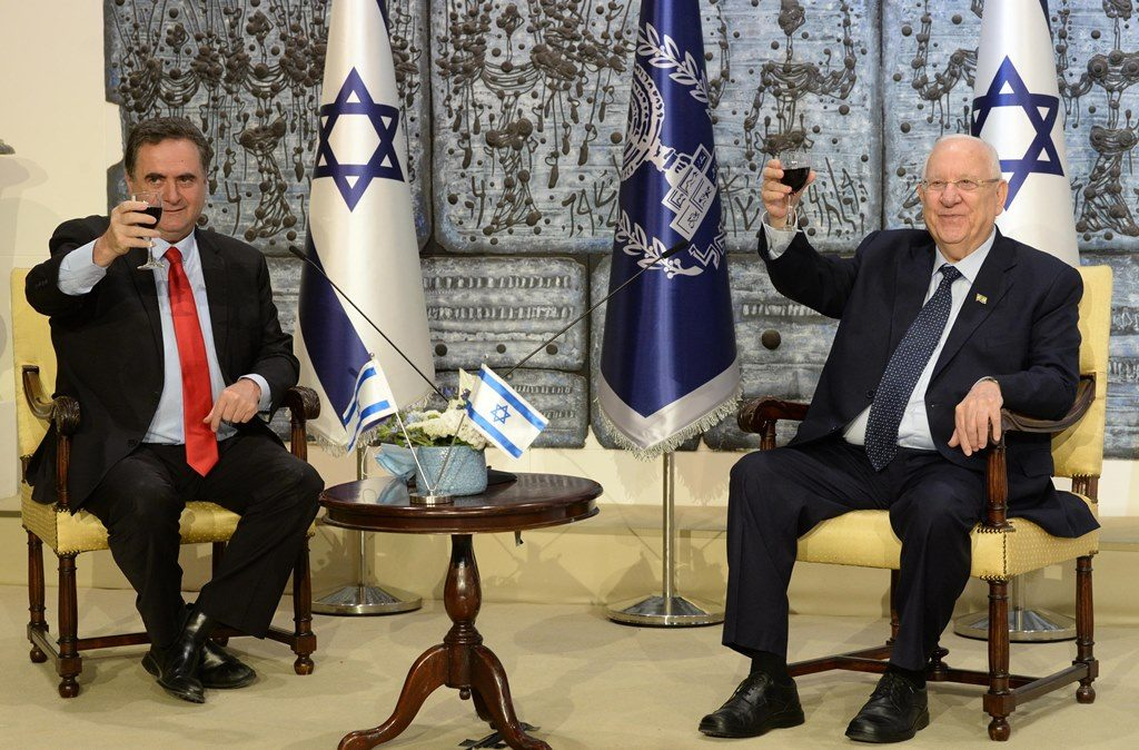 Israeli President and Foreign Minister raise a glass in toast with foreign diplomats for Independence Day