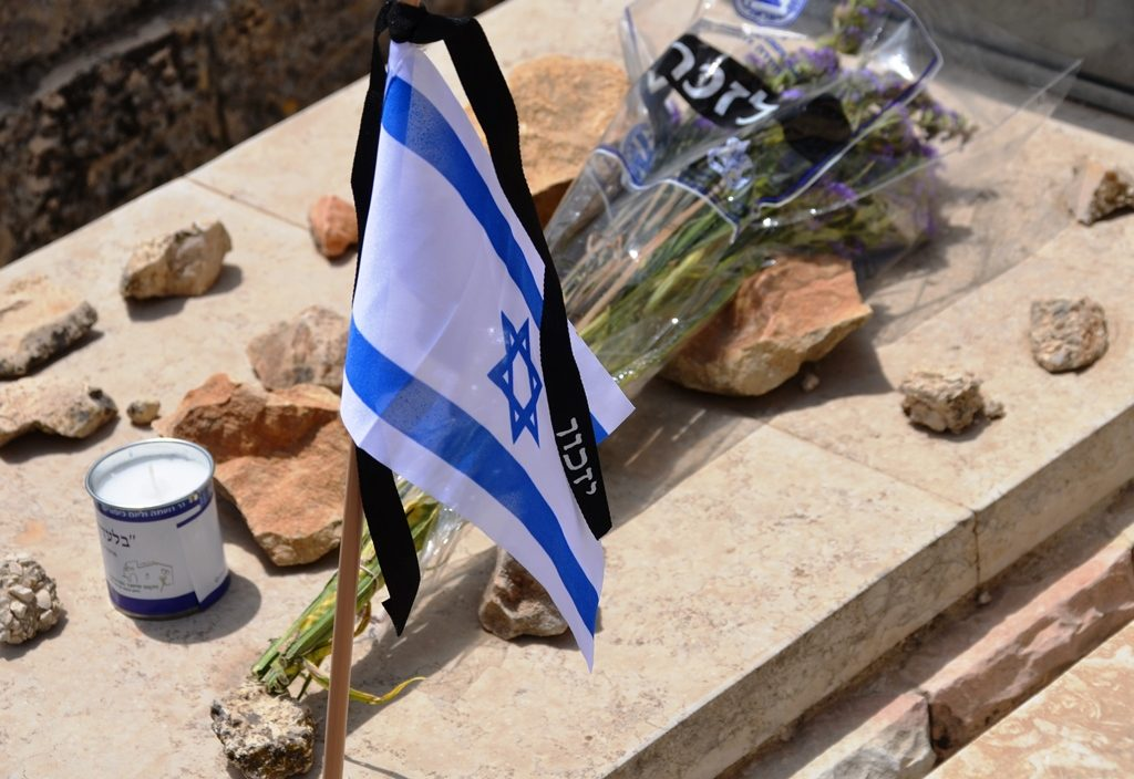 Grave on Israeli Memorial Day with flag and flower