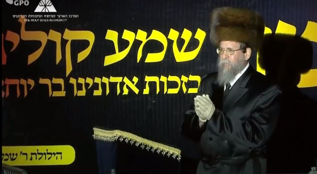 Boyaner rebbe wearing gloves at Mount Meron