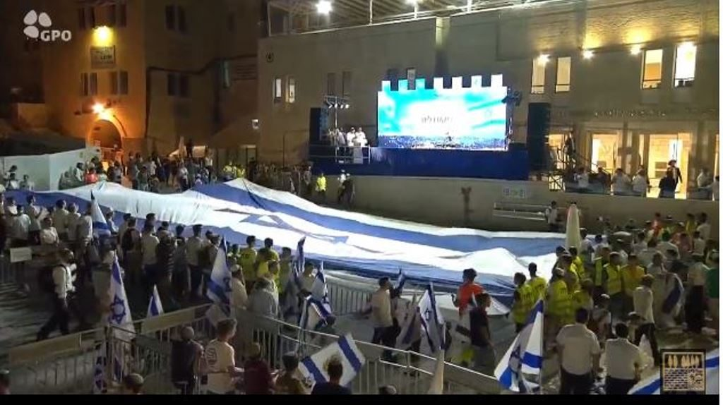 Kotel for Yom Yerushalayim with large Israel flag
