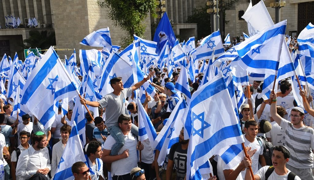 Jerusalem Day Israeli flags dancing in street