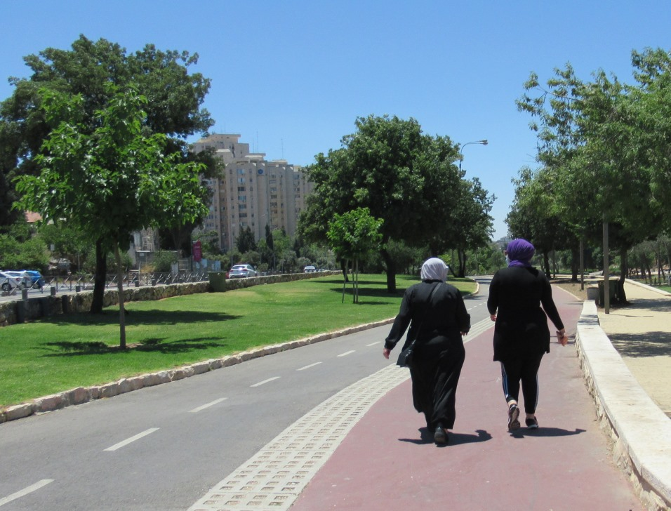 Jerusalem Israel two Muslim women walking in Gan Sacher Park