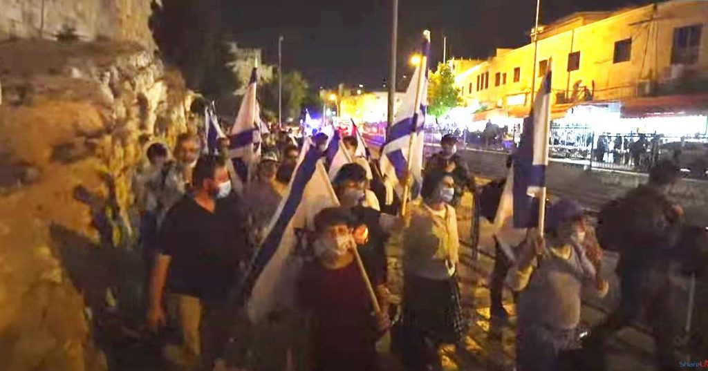 Walking in Jerusalem at night of Tisha B'Av during COVID-19 regulations