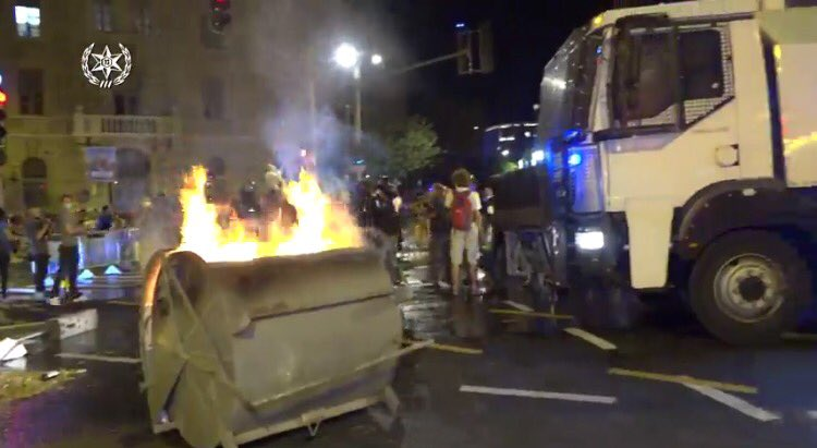 Jerusalem Israel recycle container set on fire by protesters