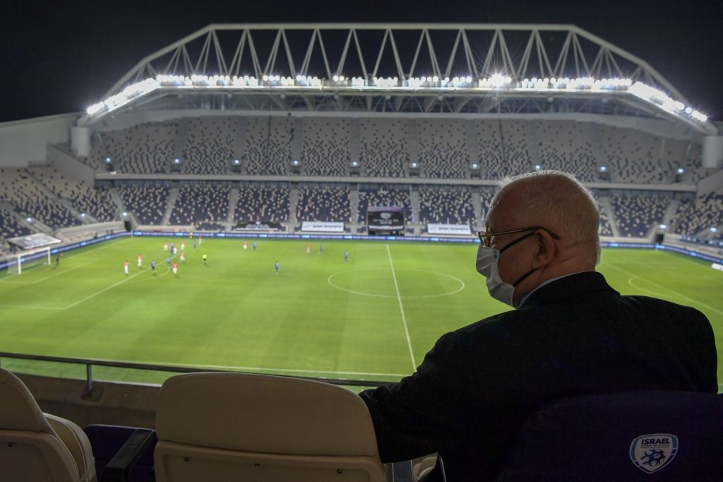 President Rivlin watches Israeli football final from a box, as the only spectator