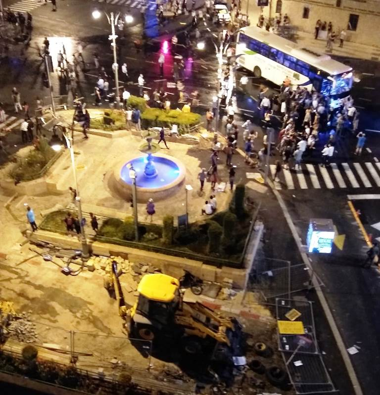 Protesters late at night at Jerusalem Israel Paris Square set fire to a paper recycling container