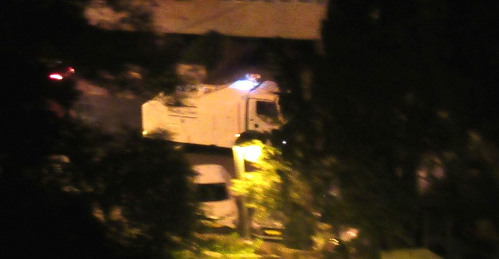 Israeli Police truck on way to burning dumpster at Paris Square