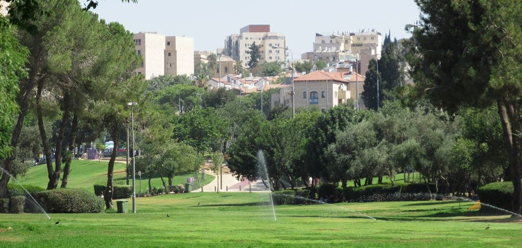 Watering Sacher Park in Jerusalem Israel no Sunday morning