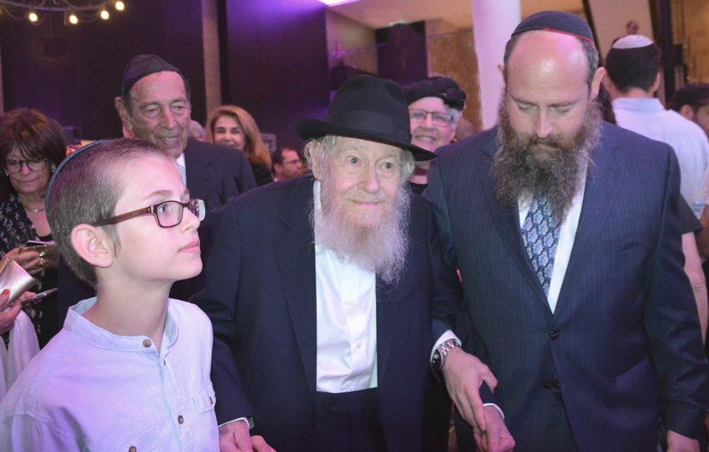 Rabbi Adin Even Israel with son Meni and grandson at dinner in his honor at Orient Hotel