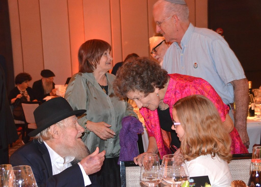 People greet Rabbi Adin Even Israel at gala dinner celebration