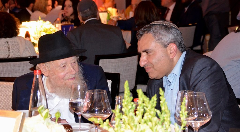 MK Zeev Elkin greeting Rabbi Adin Even Israel Steinsaltz