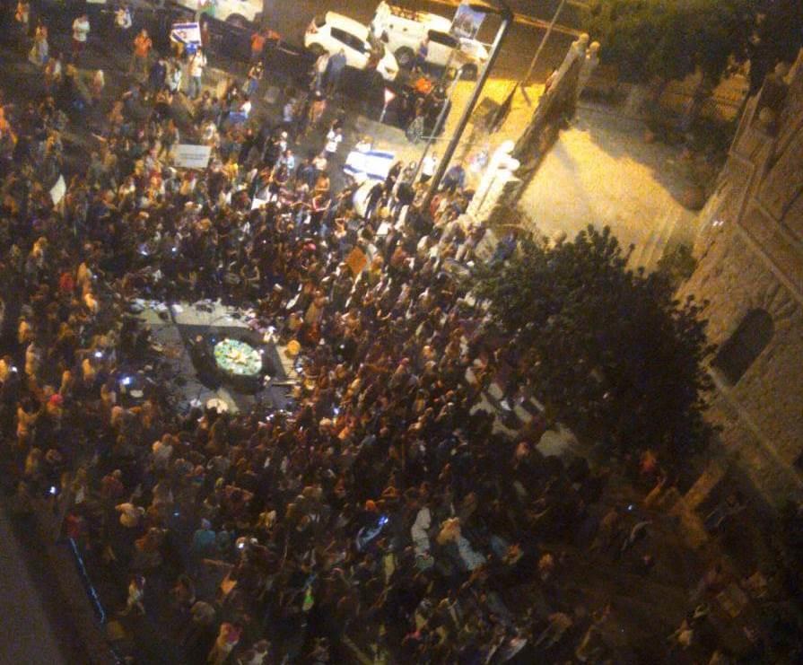 Protesters sitting on Jerusalem street near the Prime Minister's Residence