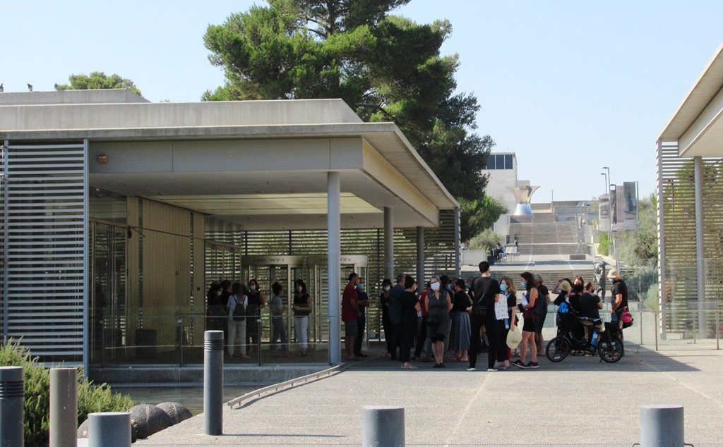 People standing outside the Israel Museum entrance in Jerusalem