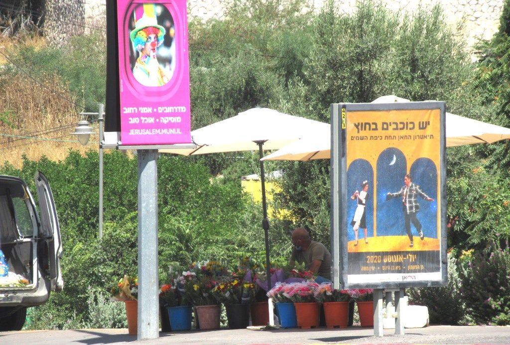 Friday afternoon in Jerusalem man selling flowers before Shabbat on street corner