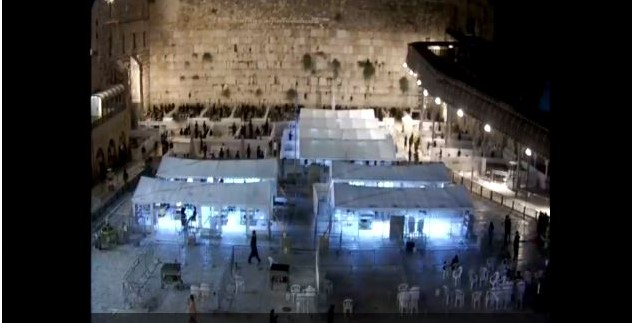 Western Wall at night during COVID-19 divided into sections