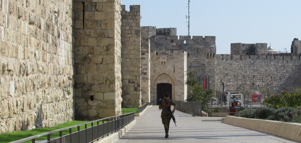 This image has an empty alt attribute; its file name is Jaffa-Gate-female-soldier-walking-toward-Old-City.jpg