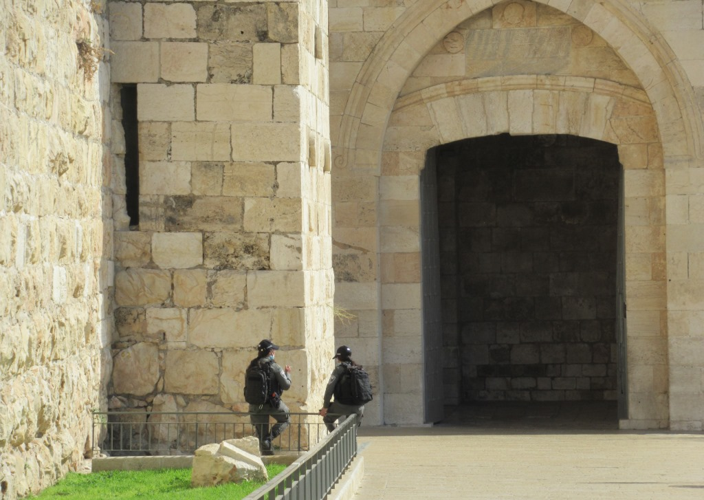 This image has an empty alt attribute; its file name is Jaffa-Gate-open-with-two-female-guards-at-entrance-to-Old-City.jpg