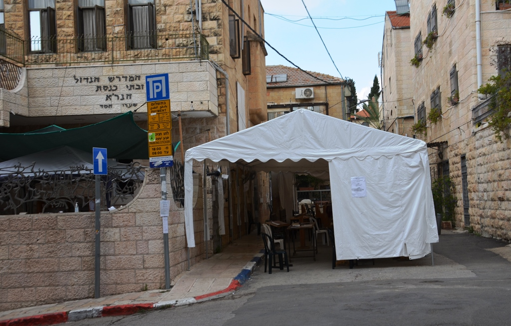 This image has an empty alt attribute; its file name is Jerusalem-Israel-tent-outside-of-yeshiva-building.jpg
